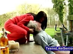 Gorgeous teen gives old man a great blowjob outdoors