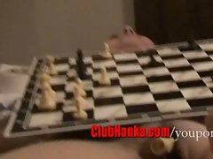 Chess match on naked body, pussy holds pieces.