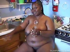 Incredibly big tits ebony whore strips and plays greasy pussy