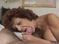Brunette granny in stockings excitedly sucks on man meat