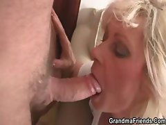 Mature widow enjoys two fresh young cocks