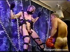 CBT blonde muscle stud is suspended as he gets his balls bashed.