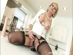 Horny blonde bimbo MILF with big boobs likes to masturbate all over the house