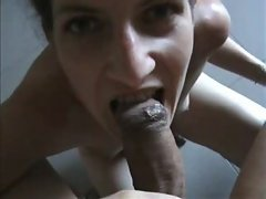 Young woman giving blowjob
