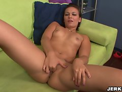 Horny babe Crissy Moon can't resist fingering her slick snatch on the sofa