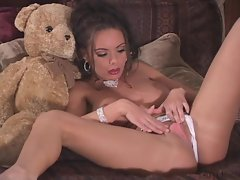 A teddy bear gets rubbed on the twat of Crissy Moran as she plays with her tits