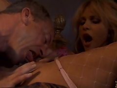 Busty babe Carmel Moore swallows cock and gets her tight snatch eaten