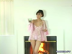 Horny asian babe Jade Hsu playing with her hot pussy on fireplace