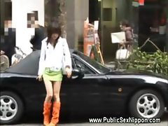 Asian slut at the window of a car