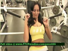 Luna brunette girl exercises at the gym