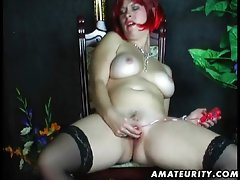 Busty redhead amateur Milf toying at home