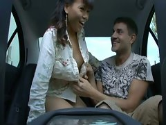 Asian chick sucks and fucks in the car