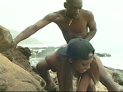 Two black romantic couple doing a hardcore funking session in beach