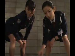 Slutty police sluts give their suspect a handjob as punishment