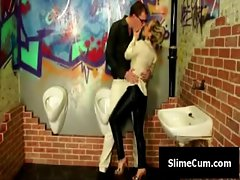 Smoking hot blonde plays with two cocks at the glory hole
