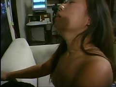 Dude in glasses fucks and facializes horny Asian on a couch